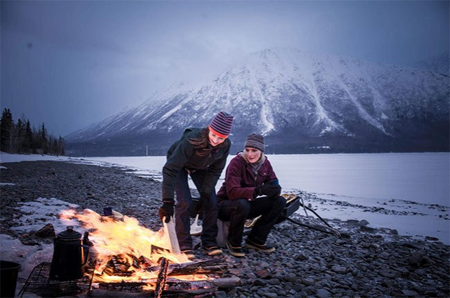 Real Women Models Nora and Gretchen by campfire in Fire Hose Jackets