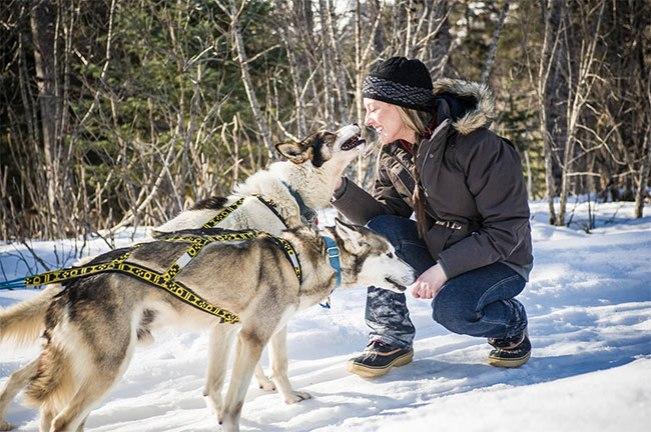 Real Women Model Amanda Vogel gets cozy with Alaskan Sled Dogs