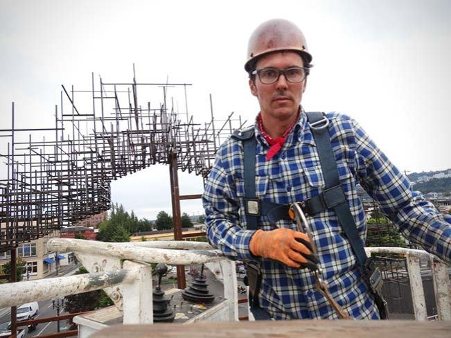 Daniel Mihalyo wearing a Crosscut Flannel in Dark Cobalt Plaid on the job creating his Inversion: Plus Minus sculpture.
