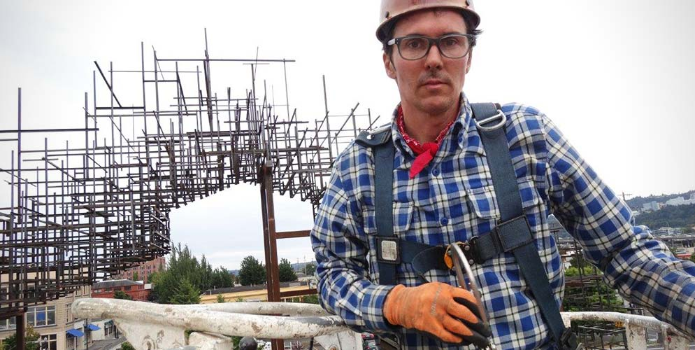 Daniel Mihalyo wearing a Crosscut Flannel in Cadet Blue on the job creating his Inversion: Plus Minus sculpture.
