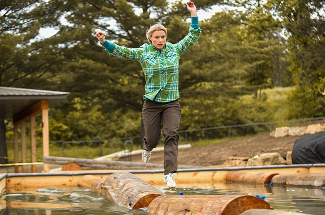 World Champion Lumberjill Shana Martin boom running on logs in a Crosscut Flannel Shirt.