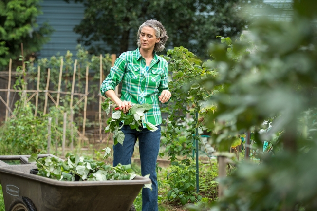 Gardening Tips for Hunger Relief featuring Shara from Green Table Cooperative wearing Crosscut Flannel Shirt