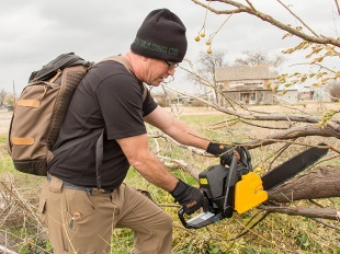 Minuteman Storm Chasers Clearing Downed Trees With Chainsaw